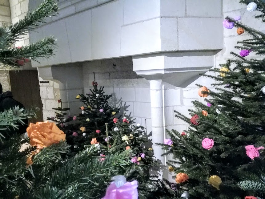 "Christmas at the Royal Fortress of Chinon As a symbol of ""rebirth"", the pine tree was associated to Christmas throughout the Middle Ages. By the end of the 15th century, it started to be used inside houses. Since then, its decoration evoluted gradually (Photo FC)"